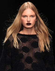 From brick red to the Goth-girl black-red at Emanuel Ungaro, moody lip shades were a big hit on the fall runways—and we're obsessed.
