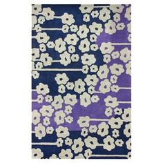 Create an eye-catching focal point in your den, dining room, or master suite with this hand-tufted wool rug, showcasing a whimsical floral motif for pop of garden-chic appeal.    Product: RugConstruction Material: WoolColor: Purple and navyFeatures:  Hand-tufted Floral motif Note: Please be aware that actual colors may vary from those shown on your screen. Accent rugs may also not show the entire pattern that the corresponding area rugs have.