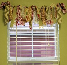 Fabric Scrap Valance - cut into strips & cut ends in different angles - tie onto curtain rod!