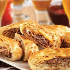 These upscale cheesesteak sandwiches feature flaky puff pastry instead of ordinary rolls.  They're easy to make, and even easier to enjoy! Comments