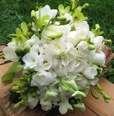 White roses and green orchids with stephanotis for a Vermont wedding.