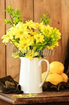 Still life spring flowers and lemons in rustic setting