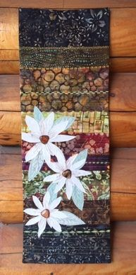 Quick little wall quilt using the journal cover tutorial from On the Trail Creations