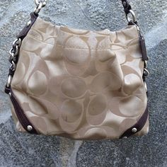 Authentic tan & brown Coach purse Beautiful, pre-loved AUTHENTIC Coach purse. Obvious signs of wear, but still has a lot of life left in it. Pockets for cell phone & other odds and ends as well as a decent sized zipper pocket. No outside pockets. Coach Bags