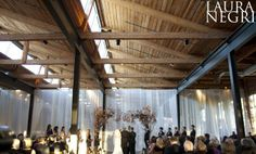 Puritan Mill Atlanta, GA - Love how its a dual venue with ceremony and reception, divided by sheer curtains. #wedding #weddingvenue #atlantawedding