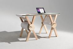 Created by designer Kirsten Camara, the Analog Memory Desk has two circular handles and a surface...