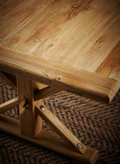 An elegant farmhouse coffee table in a light blonde elm. The table top with rounded edges, tooled details and textural grain is supported by X base legs with iron studs, joined by a simple pegged stretcher. This coffee table is perfect for stylish casual Light Blonde, Butcher Block Cutting Board, Studs, Farmhouse, Iron, Base, Legs, Coffee, Elegant
