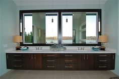 How would you love to have this double #Caesarstone vanity with gorgeous river views designed by Zetterberg Construction? #stunning #interiordesign #quartz #bath #bathroom #luxuryinteriordesign