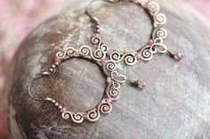 Wire wrapped copper boho hoop earrings with pale pink