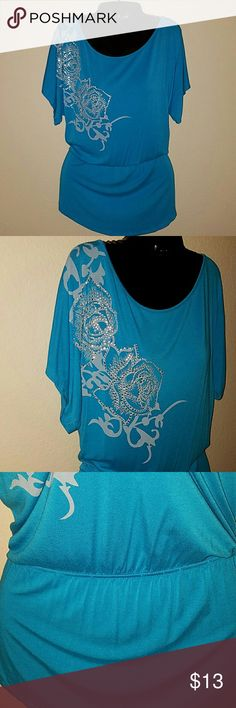 Gorgeous Blue Bling Top Like new top and an elastic waistband for a very flattering look. Pretty bling roses on one side. Can be worn symmetric or off one shouler.soft material Tops