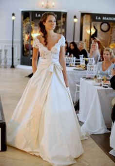 This dress is stunning! Love the combination of lace and satin with the bow! #Weddings