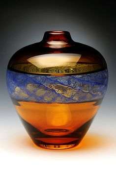 "Really beautiful....""Merletto in Blue"" created by David Russell - golden amber glass that uses the incalmo technique to showcase a central window of blue cane work in the merletto pattern."