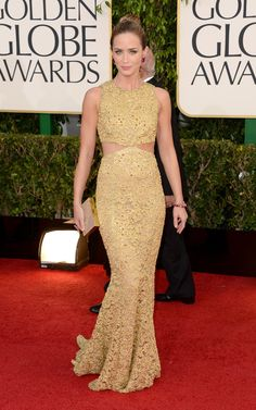 Emily Blunt glistened in a gold cutout Michael Kors gown and punchy pink jewels.  Golden Globes Red Carpet Pictures 2013