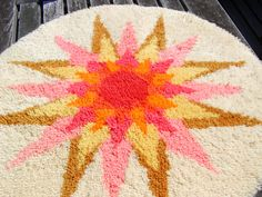 Vintage 33 Inch Round Latch Hook Rug Cream with Sunburst Pinks, Yellow, Gold, Red...by RosainGlousta via Etsy.