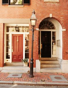 NEED to give our boring white door a make-over: can't decide between red or black for our red brick house...