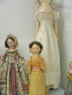 The wooden doll on the right in white was very tall.   I wish I had thought to bring a measuring tape. My best guess is she is over three fe...