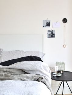 #bedroom in grey tones with black and white