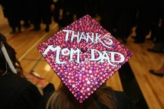 """""""Thanks Mom & Dad"""" bedazzled graduation cap. Photo courtesy of UNO Photographer, Tim Fitzgerald."""