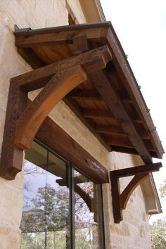 No overhang, stained wood over window and matching flower box under