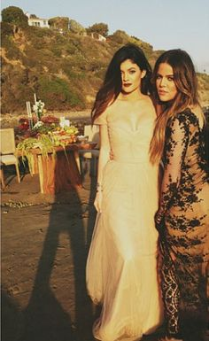 Kylie Jenner poses with Sister Khloe Kardashian in a white gown for a Family Photoshoot