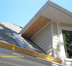 How to Repair Rotted Soffit and Fascia photo tutorial. Rehang the gutter and install roof valley flashing to direct water away from the fascia board.