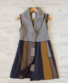 Ileen Miller's sweater vest is made from a felted sweater and pieces of coordinating wool all stitched together. Get the complete tutorial inside Altered Couture.