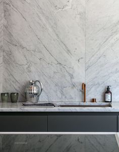 Beautiful use of marble in this bathroom. Tiles and a fabricated vanity top like…