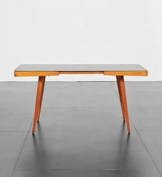 Anonymous; Beech and Glass Coffee Table by Interier Praha, 1950s.