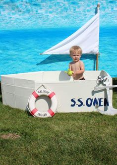 DIY sailboat photo prop for a nautical birthday party by Buzzworthy Parties