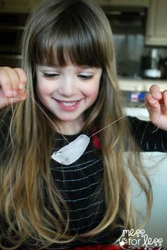 Ice Cube Experiment -Kids learn how to lift an ice cube using thread and salt.