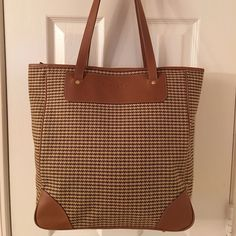 Amazing GHURKA Houndstooth Leather Trim Tote Just amazing! Gold hardware.  Zip closure.  3 interior pockets (1 zips).  Pen pocket.  Large bag.  Like new.  Leather trim.  Measures: 13x5.75x14x11. Ghurka Bags Totes