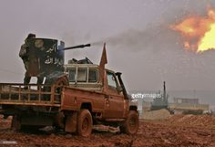 TOPSHOT - Syrian opposition fighters fire towards positions held by Islamic State (IS) group jihadists in al-Bab on the northeastern outskirts of the northern embattled city of Aleppo on December 13, 2016.