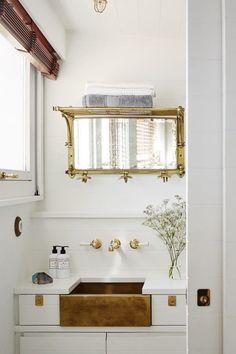 An Impossibly Tiny (but Glamorous) Seaside Cabin in the South of France | Luxe compact bathroom with brass fitting in a French cabin designed by Humbert & Poyet.