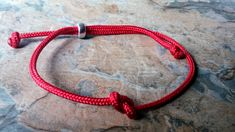 A Lovely Red Paracord Infinity Bracelet, Adjustable so will fit all sizes of wrists, Unisex Bracelet, Red is thought to be the colour for Good Luck and also Protection. Would make a lovely gift or a friend or loved one Braided Bracelets, Paracord Bracelets, Friendship Bracelets, Handmade Beads, Adjustable Bracelet, Rose Quartz, Earring Set, Personalized Gifts, Infinity
