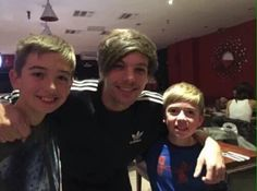 Louis today with fans in London