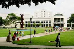 BUTLER PLAZA. #NewCoogs will want to memorize the name of this space! Here you'll often find free T-shirt giveaways, food, games, and a whole lot more. The building in the background is the M.D. Anderson Library.