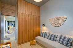 The fixed furniture, created to match the building's sculptural look, are the work of interior architect Hanni Koroma. Log Homes, Scandinavian Style, Tall Cabinet Storage, Architecture, Building, Interior, Country Living, House, Inspiration