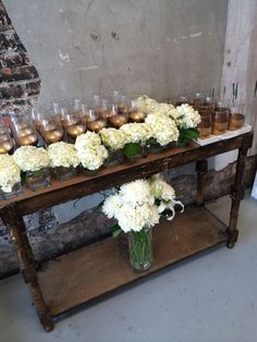 Dollar Store wine glass dipped in gold and dollar store vases for hydrangeas. #MrGoodwillHunting