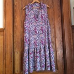 Gap print dress XL pretty Gap bottom down dress.  This is another re-Posh - looks great, just not on me.  It's a background of lavender with pretty creams and pinks.  Light weight, not very sheer.  Wide ruffle on the bottom and ruffle around the neck.  Super-sweet! Gap Dresses