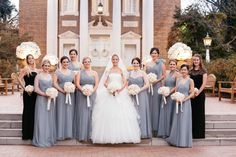 Bridesmaids with white and pink bouquets ribbons
