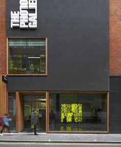 The Photo Gallery. Black render, timber, white signage, brick