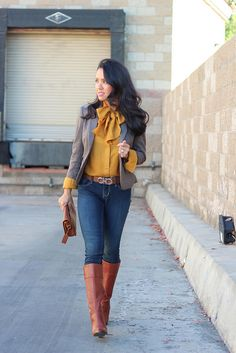 Mustard bow top, blazer, Ferragamo belt, denim jeans, brown leather purse and cognac boots //  Click on the following link to view more photos and details: http://www.stylishpetite.com/2012/11/ferragamo-gancini-reversible-belt.html
