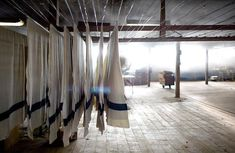 US Navy blankets hanging upstairs after screen printing