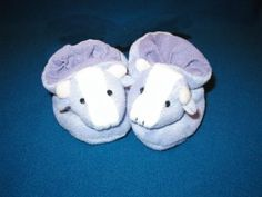 Infant Animal Slippers!  6 styles available: Purple Cow, Brown Bear, Pink Bunny, Yellow Duckie, Pink Pig and Black & White Puppy