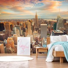 How many people can say they wake up with a view of midtown Manhatten? Perfect for a teen's bedroom, this Midtown Manhatten mural is a stylish and modern way to bring some fun city vibes to your space! Make sure to style it up with funky prints and bright decor! Choose a light wooden bed with white bedding as a base, and add bright blue blankets and pink flamingo prints for the wall. Head to the Wallsauce.com Instagram for more teen bedroom inspiration! #TeenBedroom #TeenBedroomIdeas
