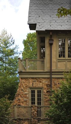 Great paint color scheme to compliment stone wall and slate roof.