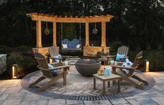 Casual Adirondack-style seating, including a bench swing hung from an angled pergola—echoed in the circular paving design—offers plenty of options for gathering around into the wee hours. Pergola Attached To House, Deck With Pergola, Metal Pergola, Wooden Pergola, Covered Pergola, Backyard Pergola, Pergola Kits, Backyard Landscaping, Pergola Ideas
