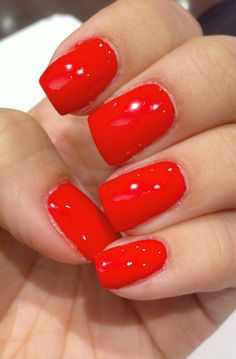 "This orange red beauty is by Essie ""Enough is Enough""."