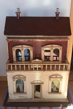 Antique doll house, was made in England, ca. 1910.   It is a G. and J. Lines Doll House and has 4 rooms with original fireplaces..  The roof has
