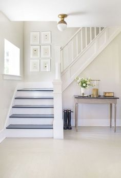 Whitewashed Entry - Gray and White Staircase in A House in the Hamptons - Lonny Mag